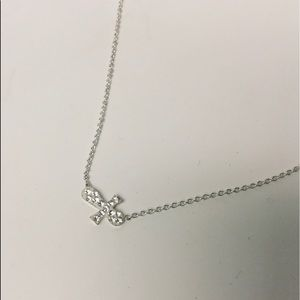 BETSEY JOHNSON CRYSTAL SIDEWAYS CROSS NECKLACE